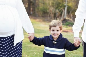maternity, richmond, little boy holding hands with parents